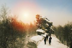 Caucasian hikers on snowy remote hilltop Stock Photos
