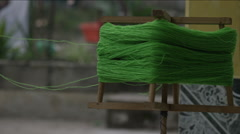 Rotating wooden reel with green wool, Guatemala Stock Footage