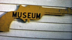 1959: Old Wild West Gun Museum free entry sign and building. Stock Footage