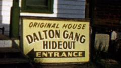1959: Dalton Gang Hideout outlaws entrance original house sign. - stock footage