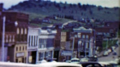 1959: Main Street Cottage Inn Cafe old mining small town. Stock Footage