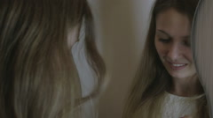Beautiful girl paints lips before mirror Stock Footage