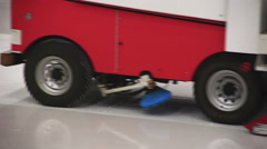 Resurfacer machine cleaning and polishing smooth ice rink before competition - stock footage