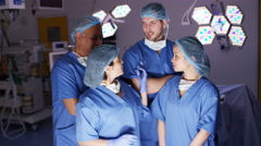 4K Portrait of smiling mixed ethnicity team of surgeons in operating theater Stock Footage