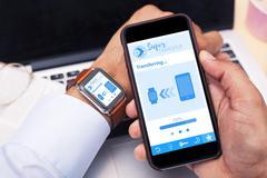 Smartphone and Smartwatch running transfer app Stock Photos