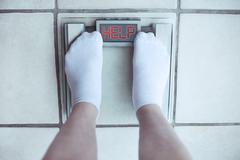 Feet on bathroom scale. Diet concept Stock Photos