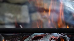 Bonfire fire flame close-up in the day light with stones background Stock Footage