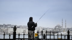 A man fishing on a large wharf Stock Footage