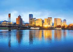 Tranquil water,cityscape and skyline of portland at sunrise Stock Photos