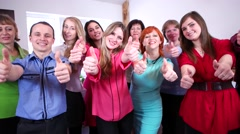 A team of people puts a thumbs up in support of the right decision. - stock footage