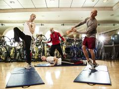 Multiple exposures of man working out with trainer Stock Photos