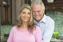 Caucasian couple smiling in kitchen Stock Photos