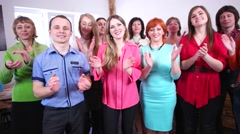 Group of people applauding and smiling gratefully looking into the camera. - stock footage