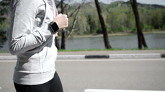 Health sport young woman run and look wear smart watch device - stock footage
