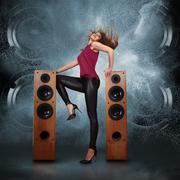 Woman dancing against of powerful speakers Stock Photos