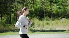 Health sport young woman run and look wear smart watch device Stock Footage