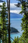 Forested island in remote lake, Queenstown, Otago, New Zealand Stock Photos