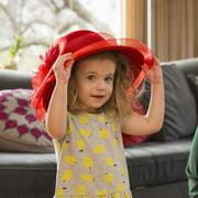 Caucasian preschooler girl playing dress-up with hat Stock Photos