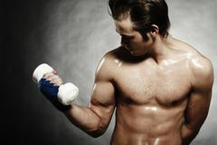 Caucasian athlete lifting weights - stock photo
