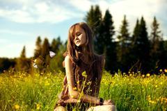 Caucasian woman sitting in field Stock Photos