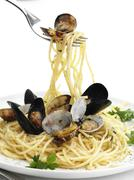 Close up of fork twirling pasta with seafood Stock Photos