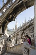 Caucasian mother and daughter photographing Milan Cathedral, Milan, Lombardy, Stock Photos