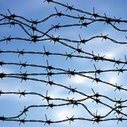 Barbed Wire Against Sky Stock Illustration