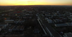 Aerial of Traffic & Buildings in Newark New Jersey East Orange On Sunset Stock Footage
