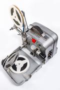 Retro old reel movie projector for cinema. A reels of motion picture film on - stock photo