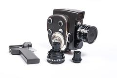 Vintage movie camera and two additional lens isolated on white - stock photo