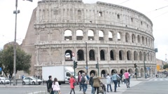 Traffic and pedestrian turists near Coliseum - Rome, Italy in spring Stock Footage