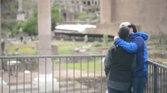 Rome, Italy - A young couple kissing and admiring the ruins Stock Footage
