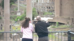 Rome, Italy - A young couple admiring the ruins Stock Footage