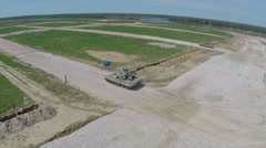 Aerial shot of tanks firing targets during playwar Stock Footage