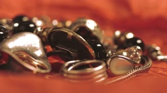 Women's jewelry products in the form of rings, silver chains and bracelets Stock Footage
