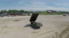 Flying over missile launcher and tanks on shooting-ground Stock Footage