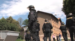 Police protect  ghetto in Prerov, street Skodova with residents people Gypsy - stock footage