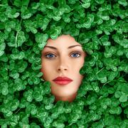 Woman face surrounded by grass Stock Photos
