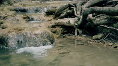 Small mountain river with rapids flowing in stony riverbed. Crimea mountains - stock footage
