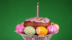 Easter cake on green background - stock footage