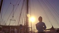 Woman running on the bridge under sunlight. Slow motion - stock footage