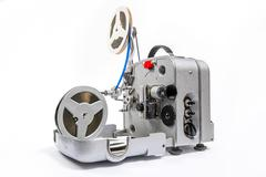 Retro old reel movie projector for cinema. A reels of motion picture film on Stock Photos