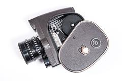 Vintage movie camera isolated on white Stock Photos