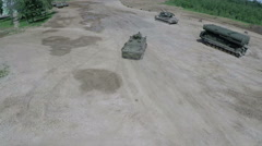 Flying over military vehicles on shooting ground Stock Footage