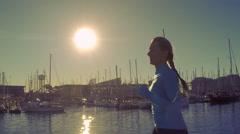 Woman running on the bridge under sunlight. Slowmotion - stock footage