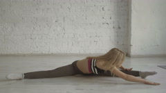 Smilig Young Cute Sportswoman Does The Splits On White Brick Wall Background Stock Footage