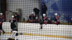 Team coach giving instructions to hockey players before they enter ice rink - stock footage