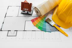 close up of house blueprint with building tools - stock photo