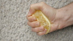 Man squeesing a lemon. Close up footage Stock Footage