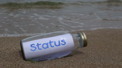 Status written on a message washed ashore Stock Footage